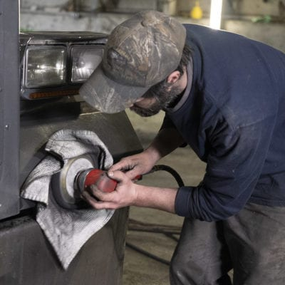 photo of man working in shop