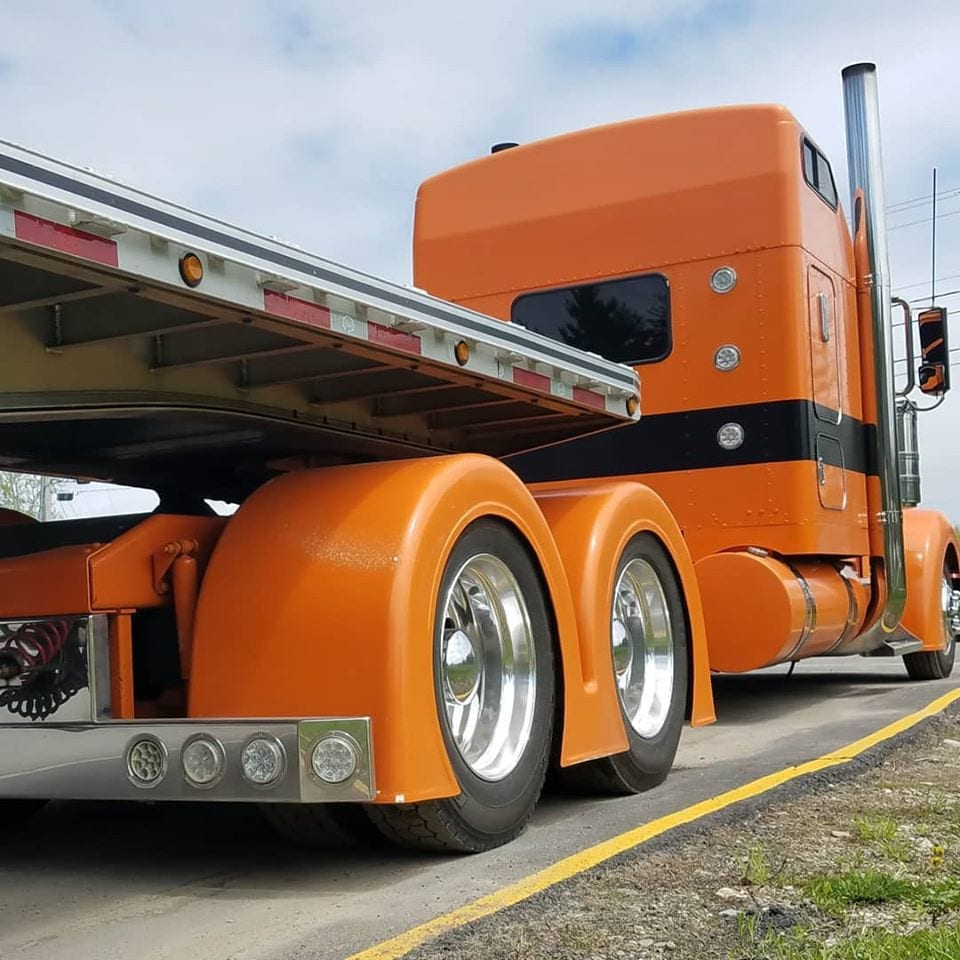 photo of orange big rig truck cab from behind