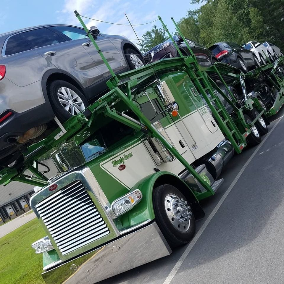 photo of green and white big rig truck cab car transport