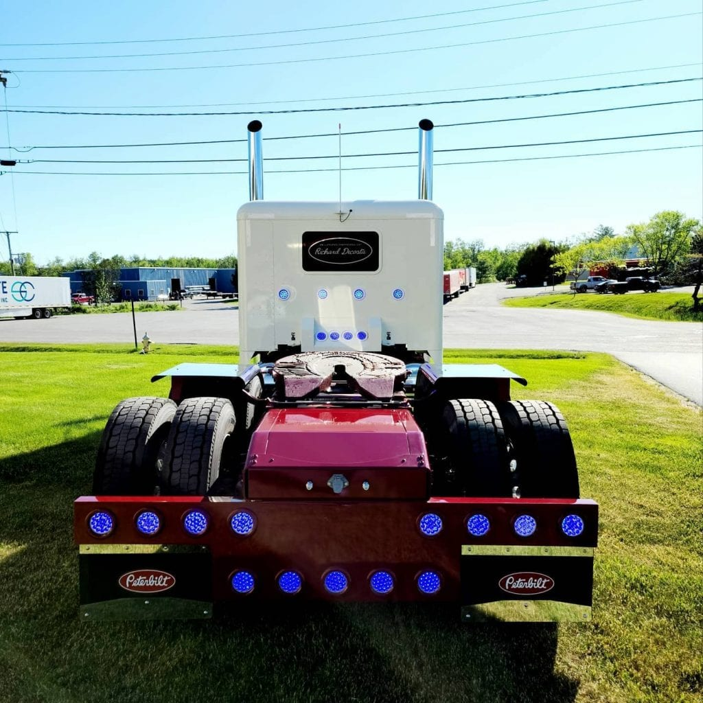 photo of big rig truck cab from the back with blue tail lights